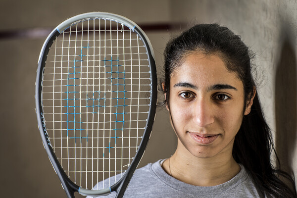 Reeham Sedky of the women's squash team poses with a squash racket.