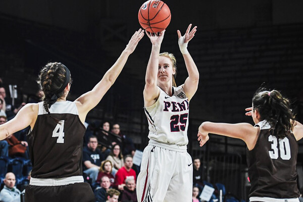 Senior guard Ashley Russell shoots a shot at a game at the Palestra.