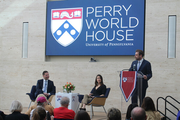 Speakers on stage at Perry World House