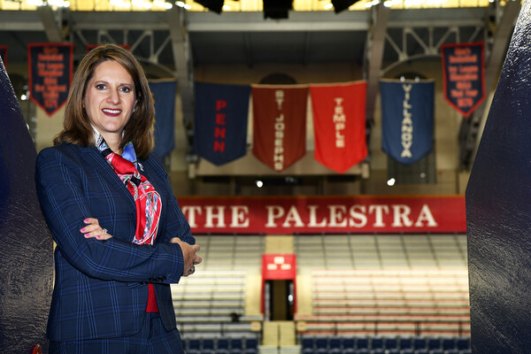 AD M. Grace Calhoun poses in the concourse at the Palestra.