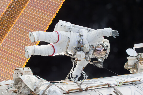 Astronaut in a space suit on a spacewalk outside the International Space Station.