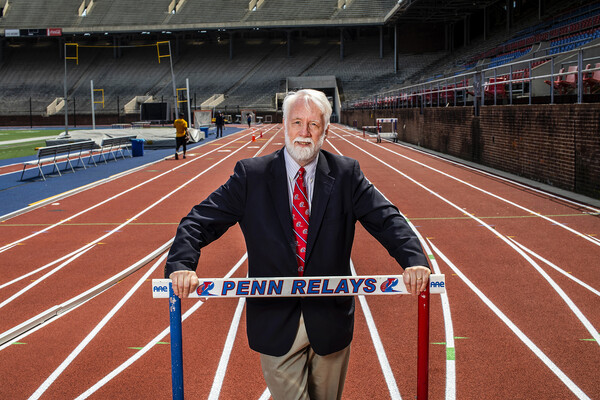 Penn Relays Director Dave Johnson poses on the track at Franklin Field.