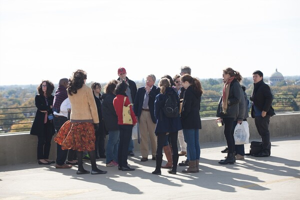 History of Art Professor David Brownlee with tour group atop concrete roof