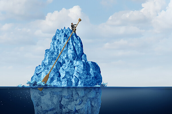 Illustration of business person on top of an iceberg in the water with an exaggeratedly long oar.