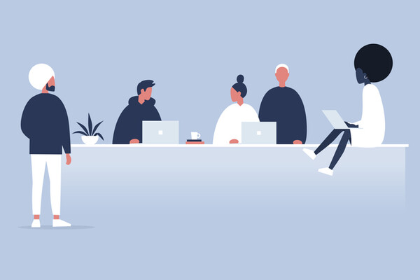 illustration of workers sitting and standing around a long office desk