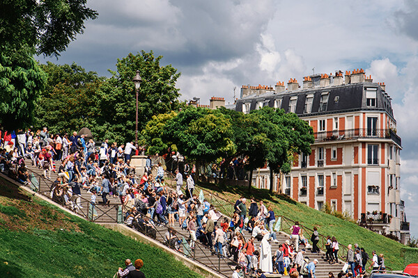 A crowd of people on an outdoor staircase in France