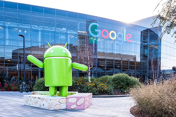 Outside of Google headquarters with large android statue