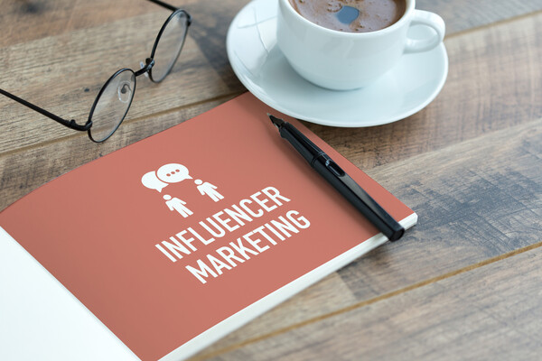 Marketing booklet with pen and coffee
