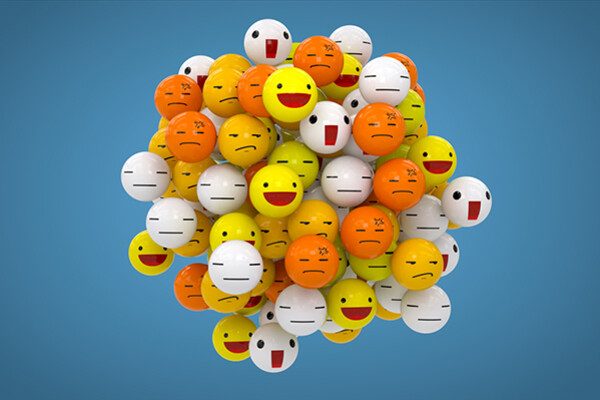Cluster of multicolored balls drawn with various emoji faces.