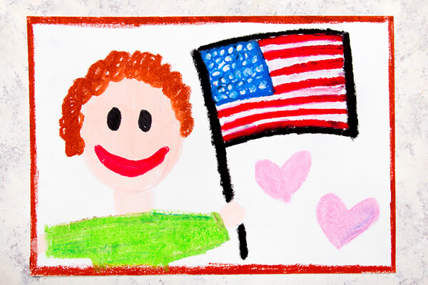 Crayon drawing of person holding an American flag