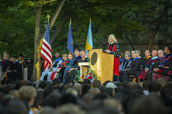 Amy Gutmann at the podium outside College Hall addressing the Class of 2023