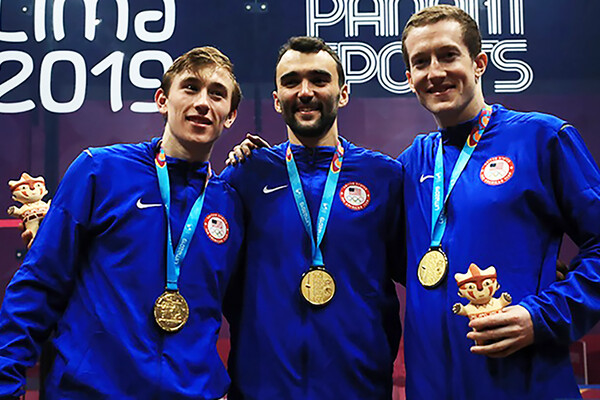 Andrew Douglas, left, poses with the gold medal-winning U.S. men's squash team.