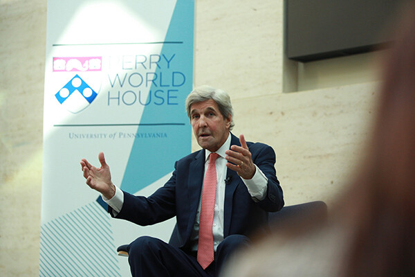 John Kerry addresses the crowd while seated on stage at the Perry World House Fall Colloquium