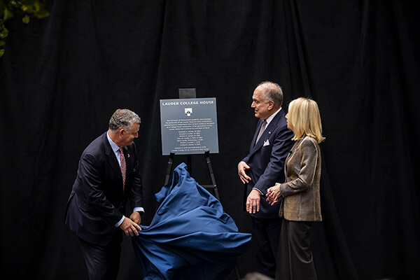 William and Ronald Lauder assist President Amy Gutmann in the revealing of the Lauder College House name.