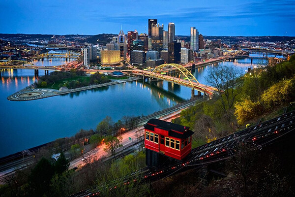 Evening view of Pittsburgh skyline along one of its rivers