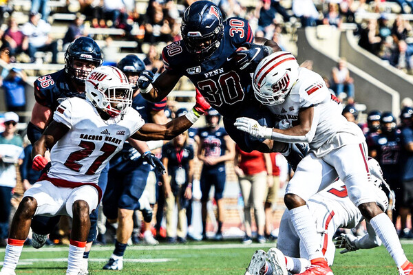 At Franklin Field against Sacred Heart, junior running back Karekin Brooks dives into the endzone.