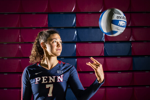 Parker Jones, a junior on the volleyball team, tosses the ball in the air during a shoot at the Palestra.