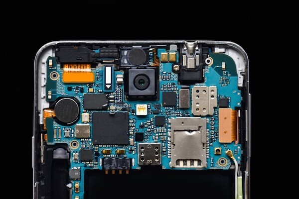 the back of an open phone showing chips and circuits