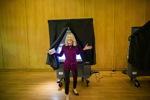 Penn President Amy Gutmann exits the voting booth at Vance Hall