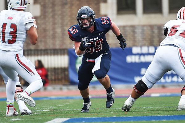 Playing at Franklin Field against Sacred Heart, Brian O'Neill rushes the quarterback.