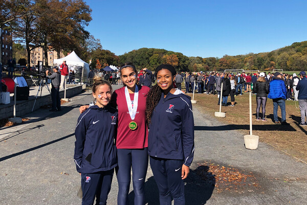From left, Ariana Gardizy, Maddie Villalba, and Nia Akins of the Penn women's cross country team stand together at the Ivy Heps in the Bronx.