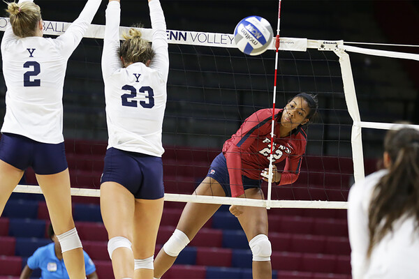 Freshman Autumn Leak of the volleyball team serves the ball against Yale at the Palestra.