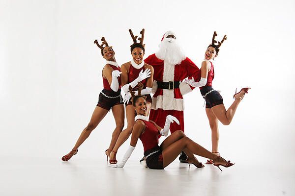 Dancers surrounding Santa Claus
