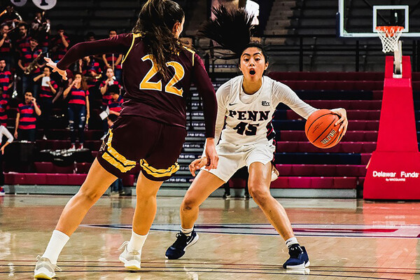 At the Palestra, guard Kayla Padilla prepares to crossover an opponent.