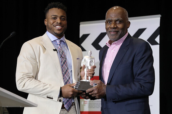 Alan Page presents Brandon Copeland with the NFLPA's Alan Page Community Service Award.