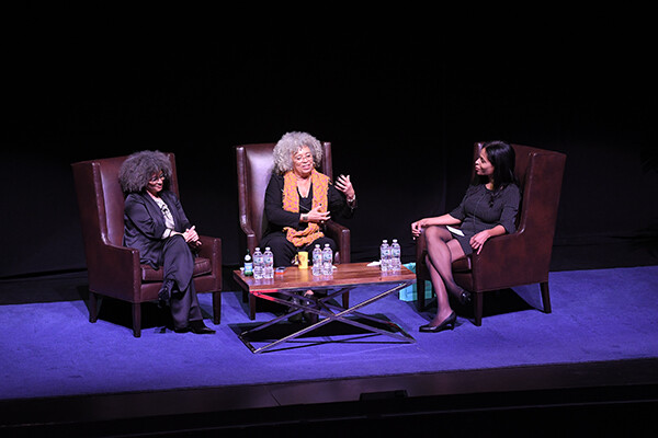 Gina Dent, Angela Davis, and Margo Natalie Crawford seated in discussion on stage