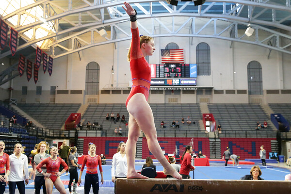 During a meet at the Palestra, freshman Rebekah Lashley performs on the beam.