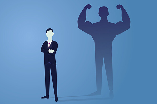 cartoon of a businessman whose shadow is flexing very large biceps