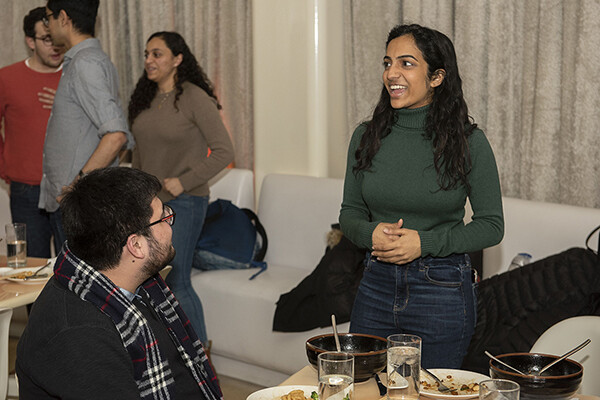 Natasha Menon talks to students at UA Dinner