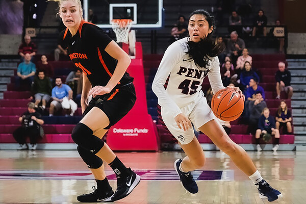 At the Palestra against Princeton, freshman guard Kayla Padilla drives to the basket with the ball.