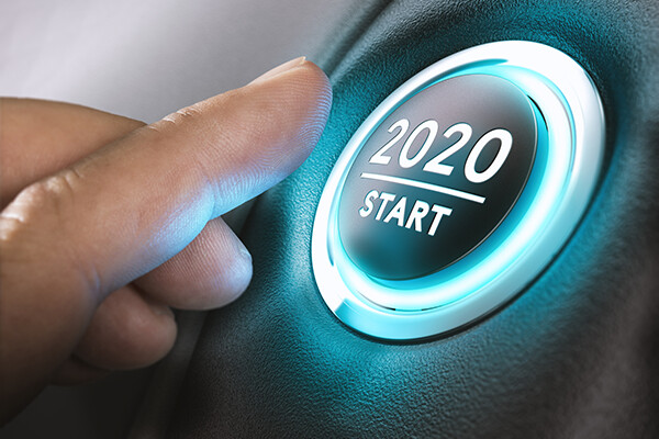 Finger about to press button that reads 2020 start