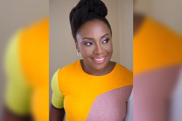 Portrait of Chimamanda Ngozi Adichie, smiling.
