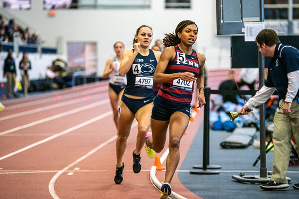 Running at the BU Valentine Invitational, middle-distance runner Nia Akins turns a corner while racing in the 800m.