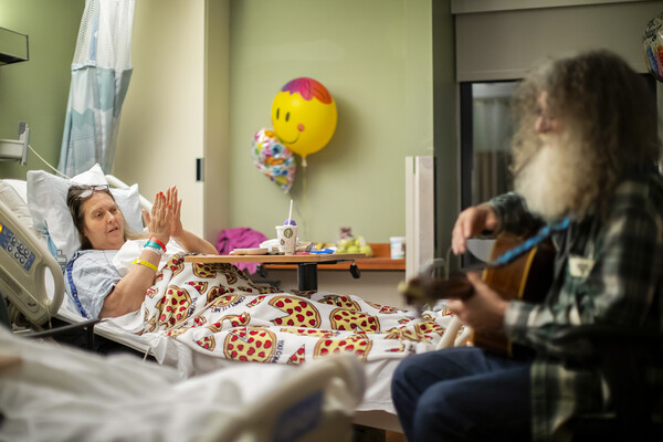 david falcone playing guitar with balloons in the background