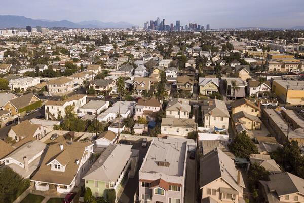 aerial view of suburban housing with LA skyline in background