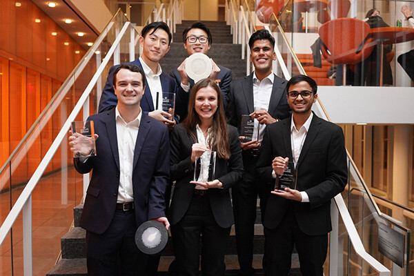 Yumin Gao, Leo Li, Minhal Dhanjy, Darsham Bhosale, Kateryna Kharenko and Ryan Goethals (clockwise from top left) pose with their prototypes and trophies.
