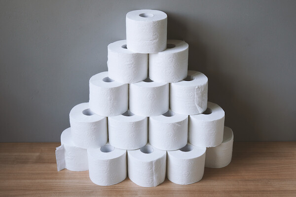 pyramid of multiple rolls of toilet paper, implying hoarding in crisis