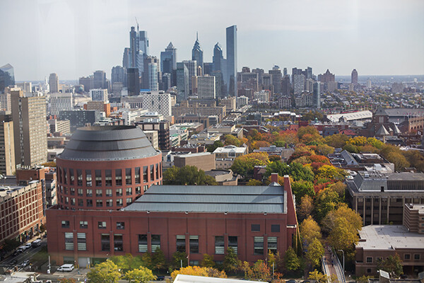 Aerial view of Huntsman Hall and the Philadelphia city skyline in daylight.