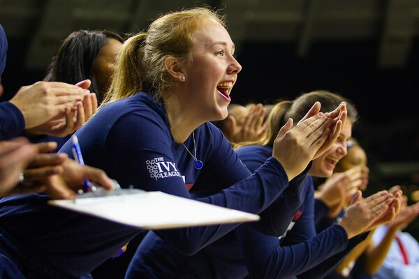 Liz Satter of the women's basketball team claps for her teammates from the bench during a game against Notre Dame.