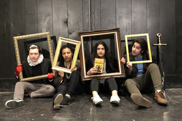 Four students sitting on the floor each with a frame around their faces, one of them holding the book titled Orlando.