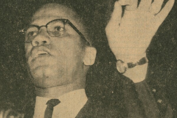 Gesturing with his hand, Malcolm X speaks at Irvine Auditorium in January of 1963.
