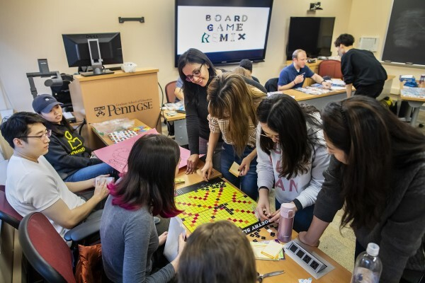 Students gather around board games