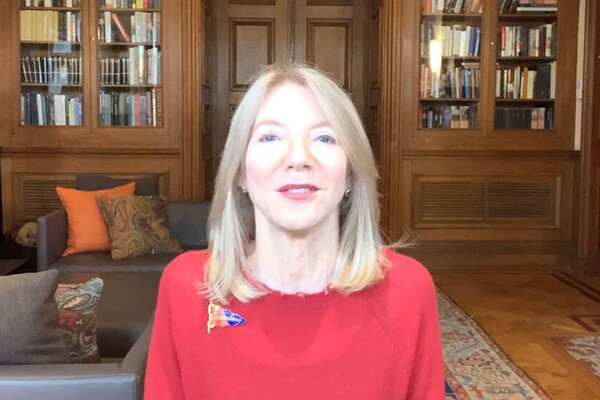 Dr. Gutmann sits at her computer and addresses the screen