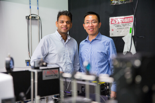 a portrait of ritesh agarwal and liang feng inside of a research lab
