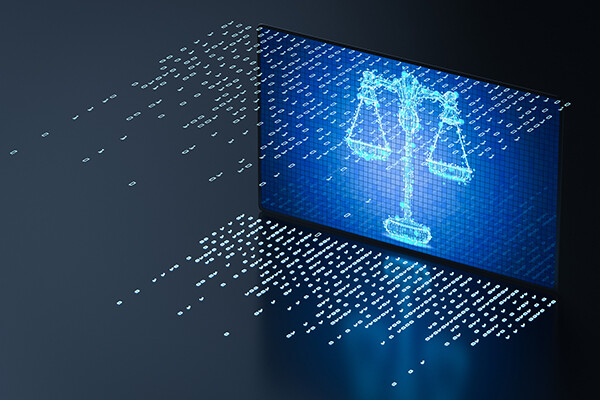Scales of justice rendered in 1s and zeroes of computer code on a computer screen.
