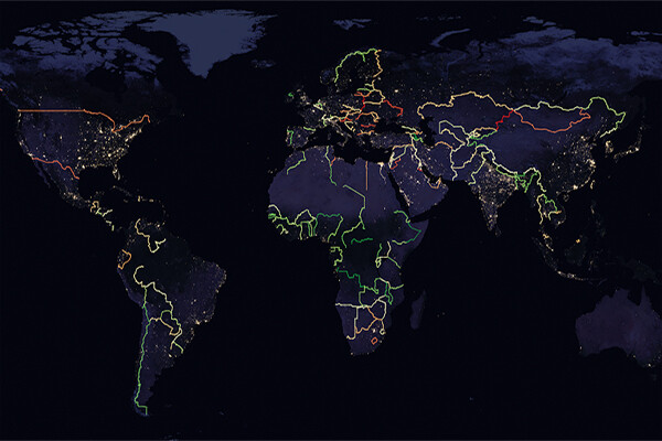 Satellite image of Earth highlighting border in different colors.